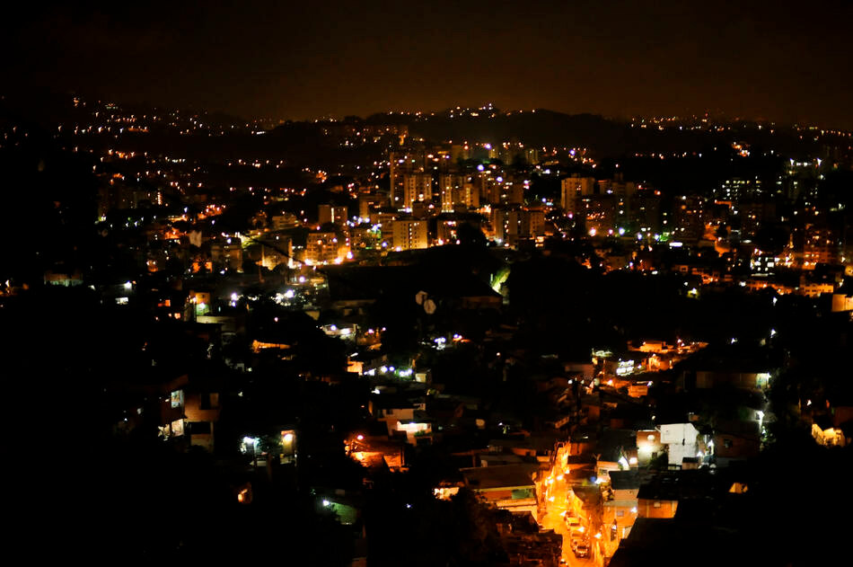 A view Petare city streets at night, a slum where members of a special tactical division of the Sucre police force conduct late night foot patrols in Caracas, Venezuela.