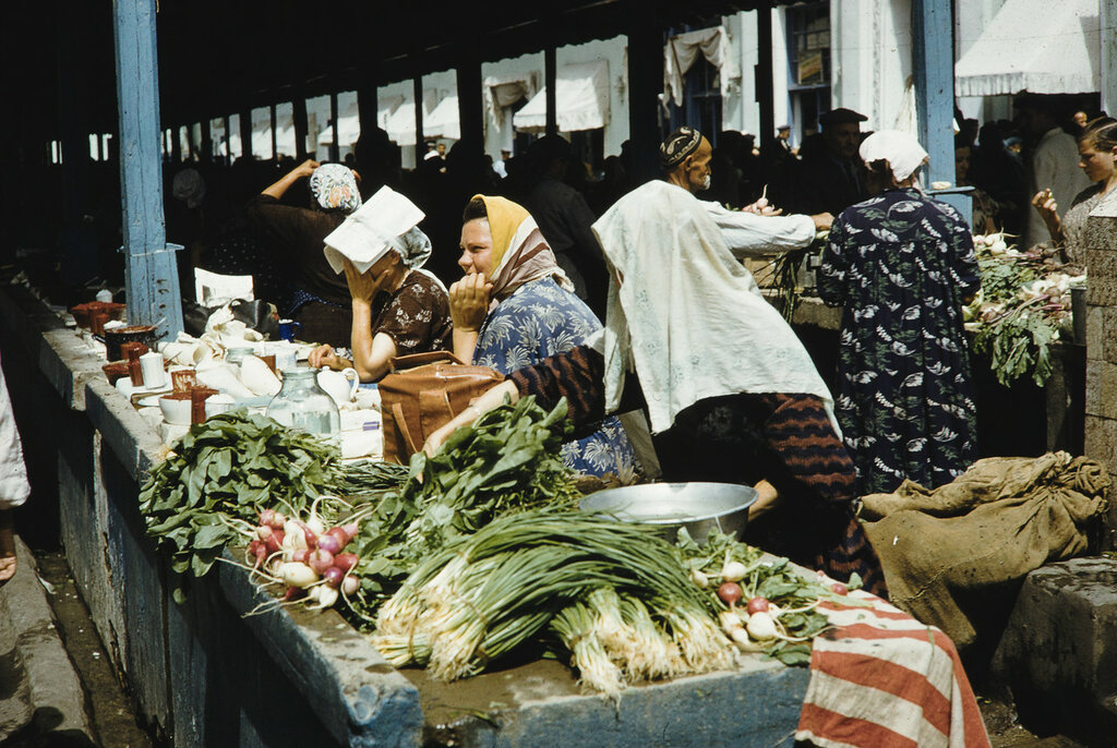 Russia, merchants selling vegetables at market