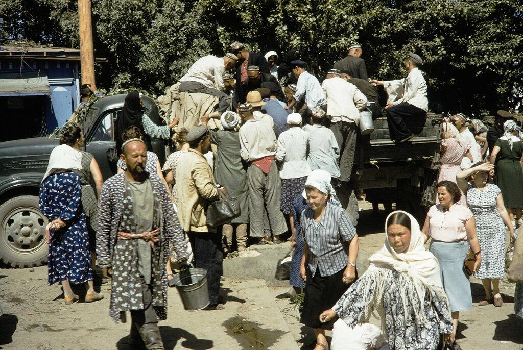 Uzbekistan, people gathered around truck at Samarkand market