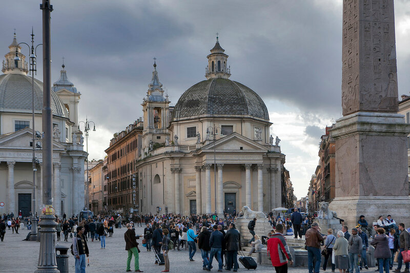 Obelisk in Piazza del Popolo, Rome. An Egyptian obelisk stands in the centre of the Piazza. Three sides of the obelisk were carved during the reign of Sety I and the fourth side, under Rameses II.