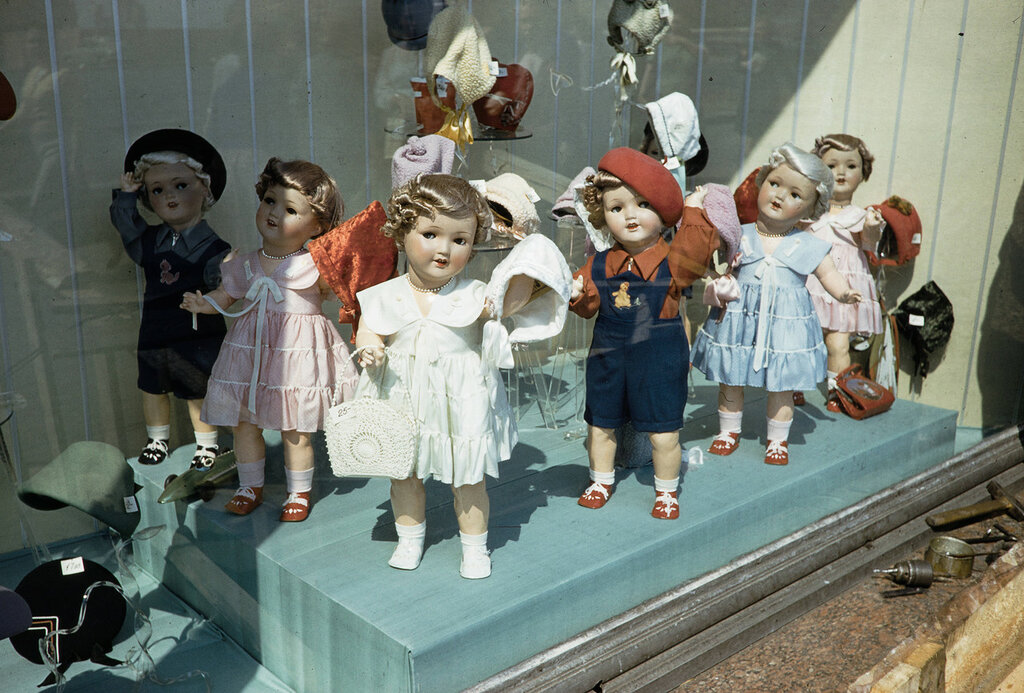 Russia, dolls in window display at store in Moscow