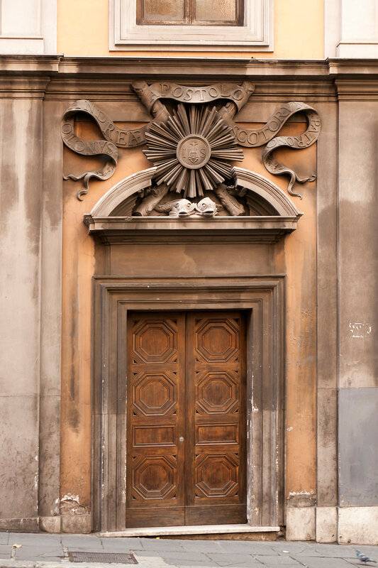 Antique classic old wood gate at Rome, Italy.