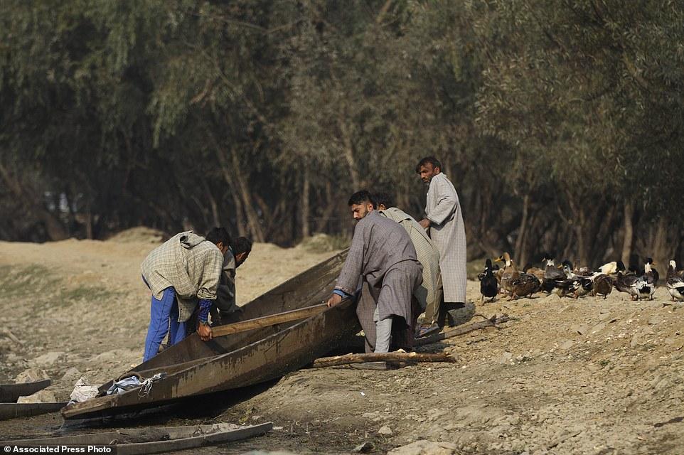 India Kashmir Reclaiming a Lake