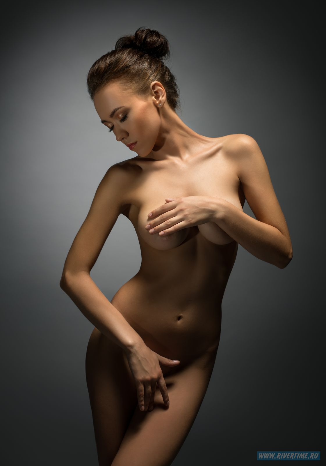 Charming beauty posing naked in studio