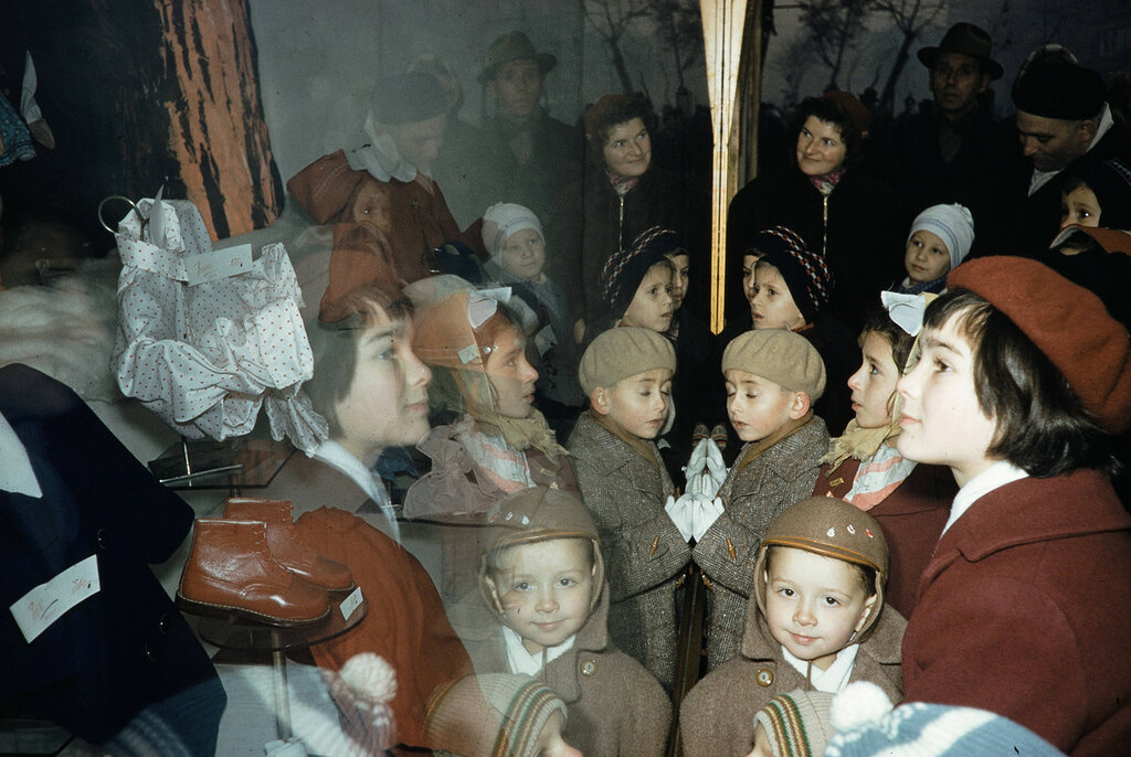 Russia, people looking at window display at store in Moscow