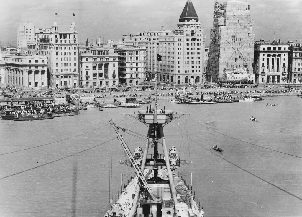 USS AUGUSTA (CA-31) View taken from her foremast, looking towards the bund, as she was being turned around to moor in the Whangpoo River at Shanghai, China, on 18 August 1937.