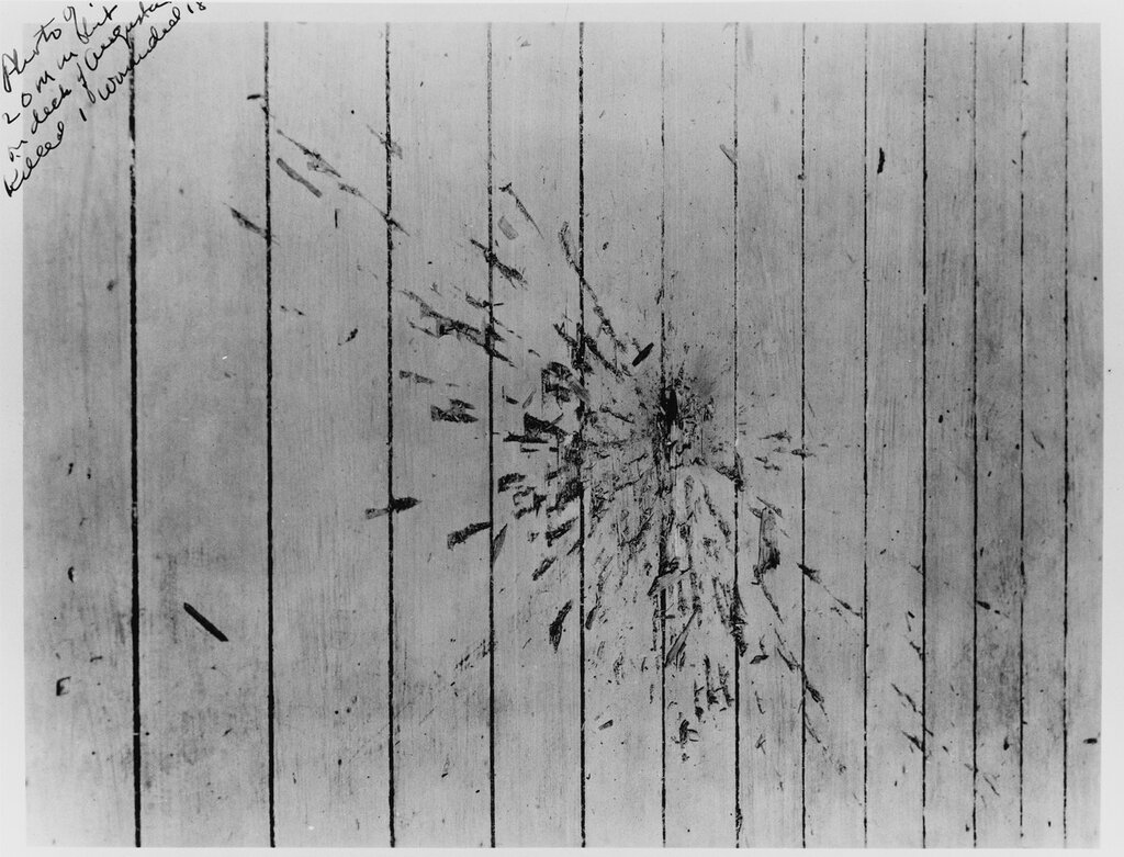 USS AUGUSTA (CA-31) View of the point-of-impact for a Chinese antiaircraft shell which landed on the well-deck of the AUGUSTA killing Seaman Second Class Freddie J. Falgout of Raceland, Louisiana and wounding 17. The incident occurred on 20 August 1937, late in the afternoon when many of the crew were gathering for the evening movies.
