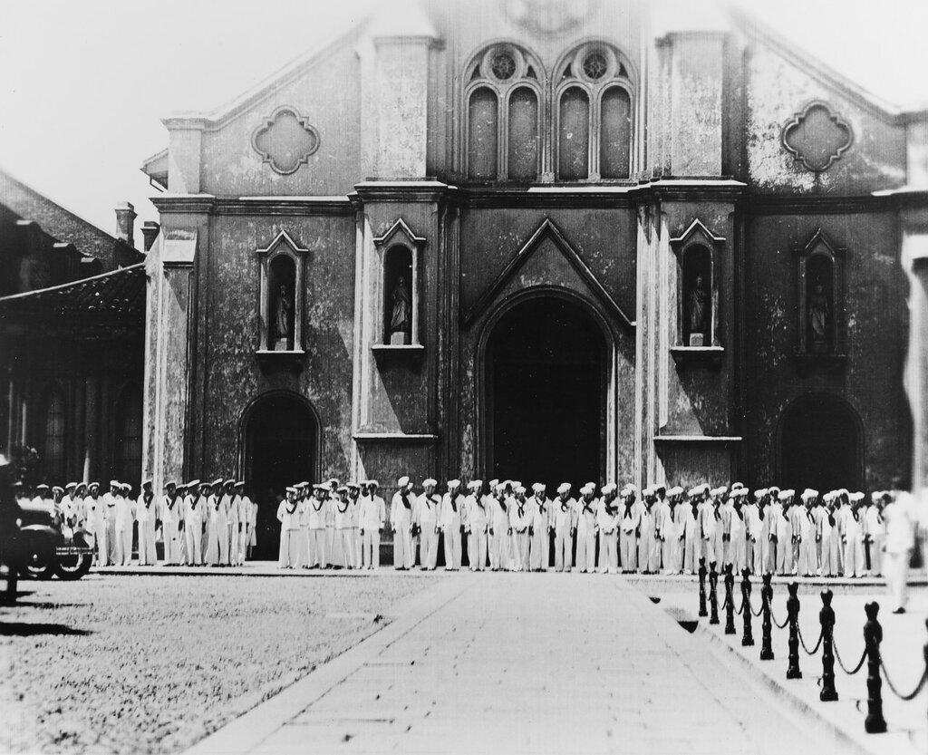 View taken of funeral delegation of neutral nations' naval personnel at services for Seaman Second Class F.J. Falgout, of Raceland, Louisiana, killed by Chinese anti-aircraft shell on 20 August 1937, aboard USS AUGUSTA. Nations represented are (from left to right): Italy, France, Great Britain and the United States. At a cathedral in Shanghai, China.