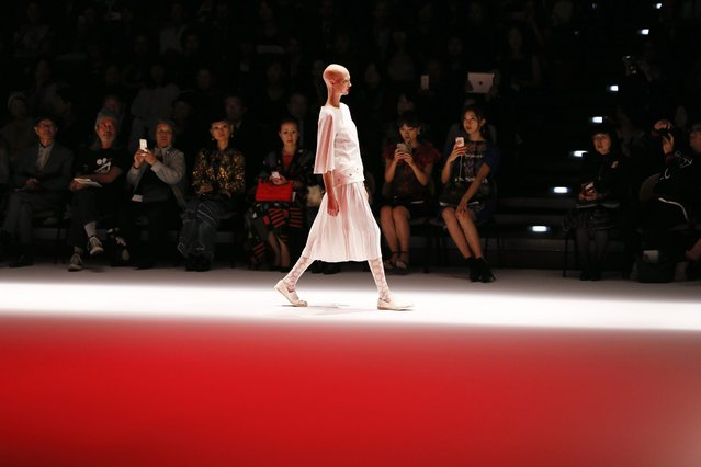 A model presents a creation by Japanese designer Hiroko Koshino for the label Hiroko Koshino during