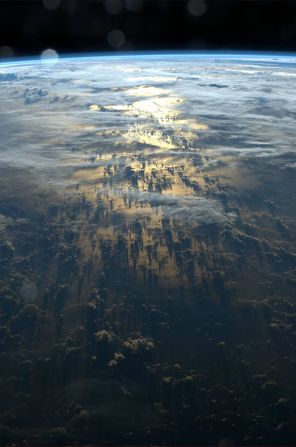 Clouds Cast Thousand-Mile Shadows into Space When Viewed Aboard the International Space Station