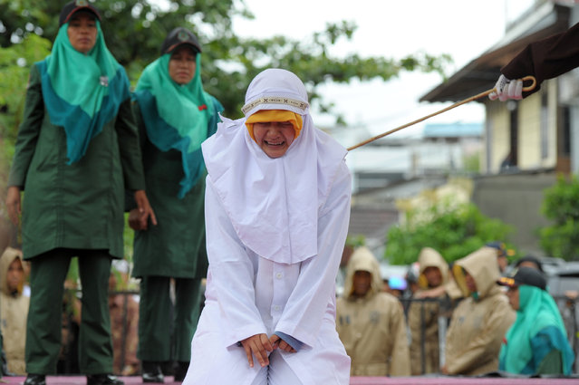 A Muslim girl gets caned 23 strokes after being caught in close proximity with her boyfriend in Band