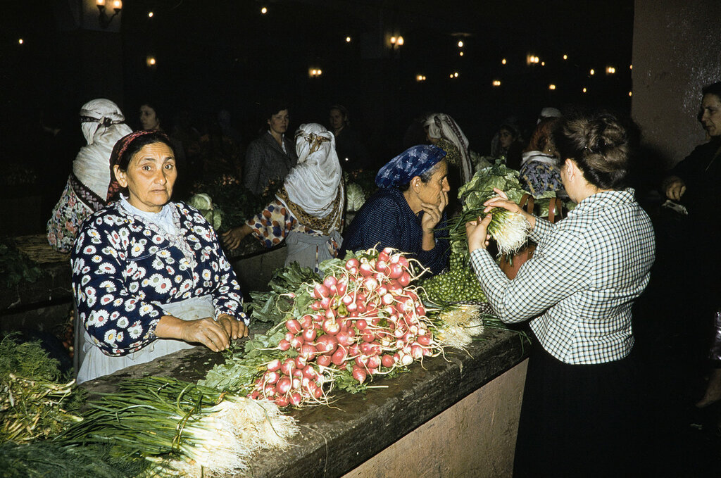 Russia, women selling goods at collective farm market