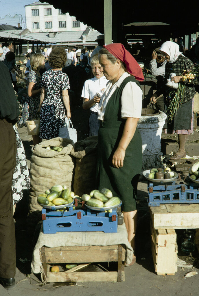 Russia, merchant selling vegetables at market