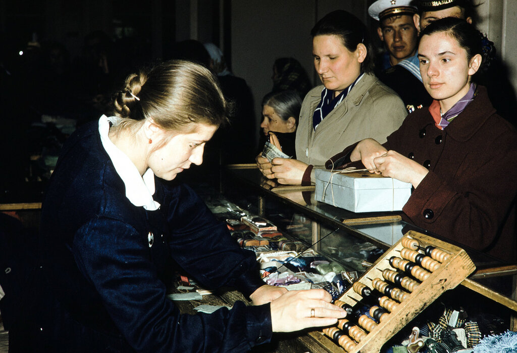 Russia, clerk assisting customers at GUM Department Store in Moscow