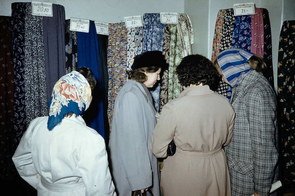 Russia, women looking at fabric for sale at store in Moscow