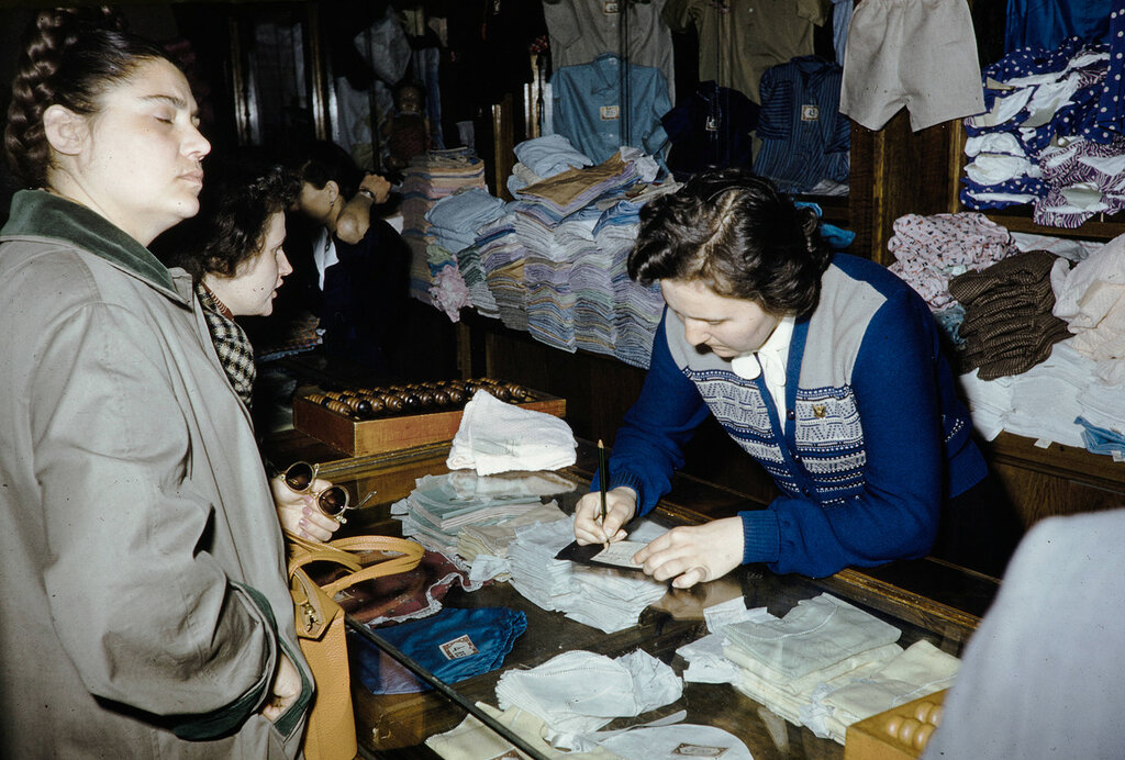 Russia, clerk assisting customers at store in Moscow