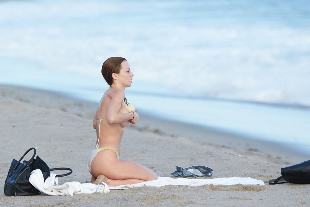 Francesca Eastwood topless on the beach