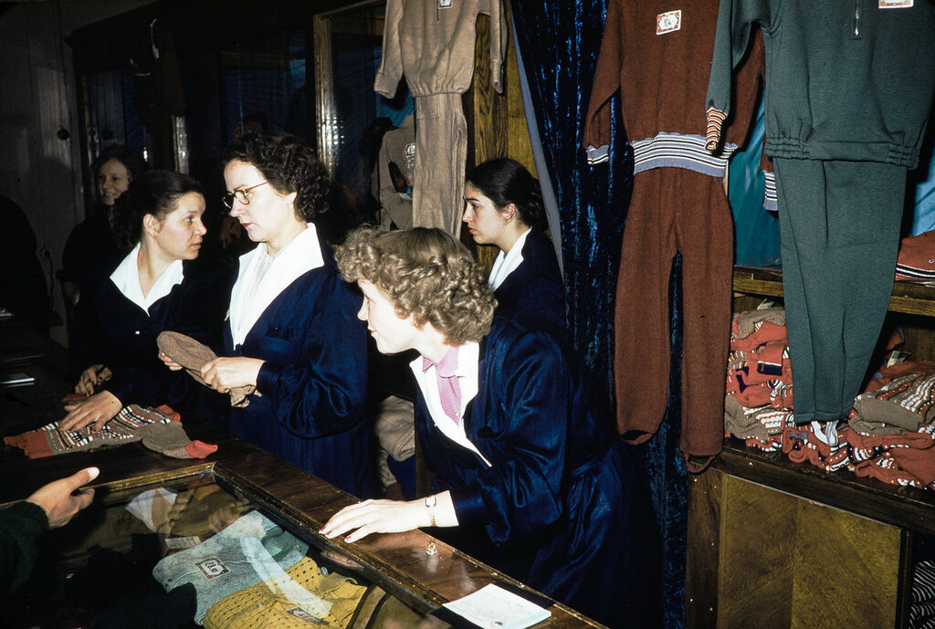 Russia, clerks assisting customers at store in Moscow