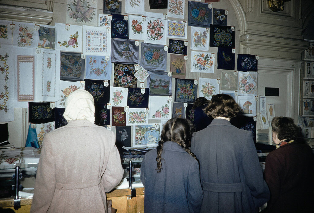 Russia, women looking at scarves for sale in Moscow