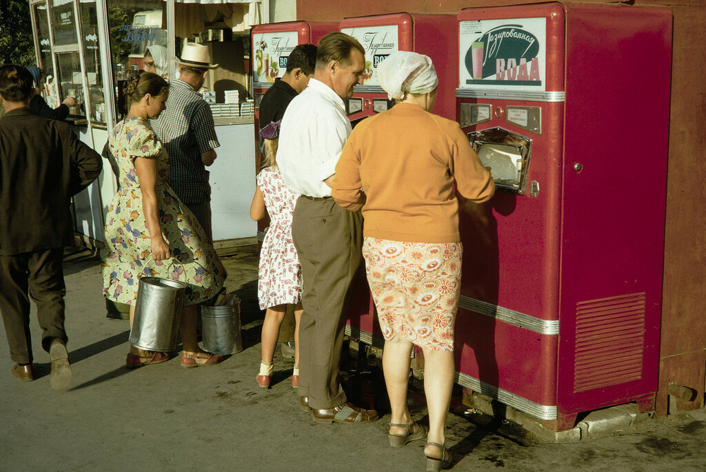 Russia, people purchasing soft drinks from vending machines in Moscow