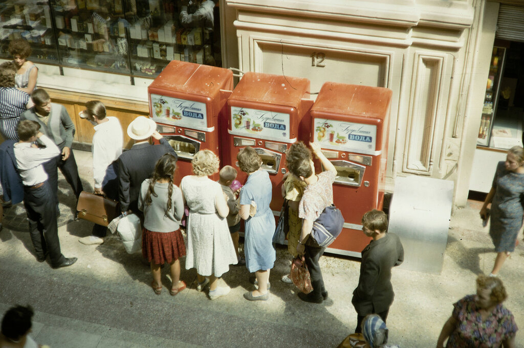 Russia, people purchasing soft drinks from vending machine in Moscow