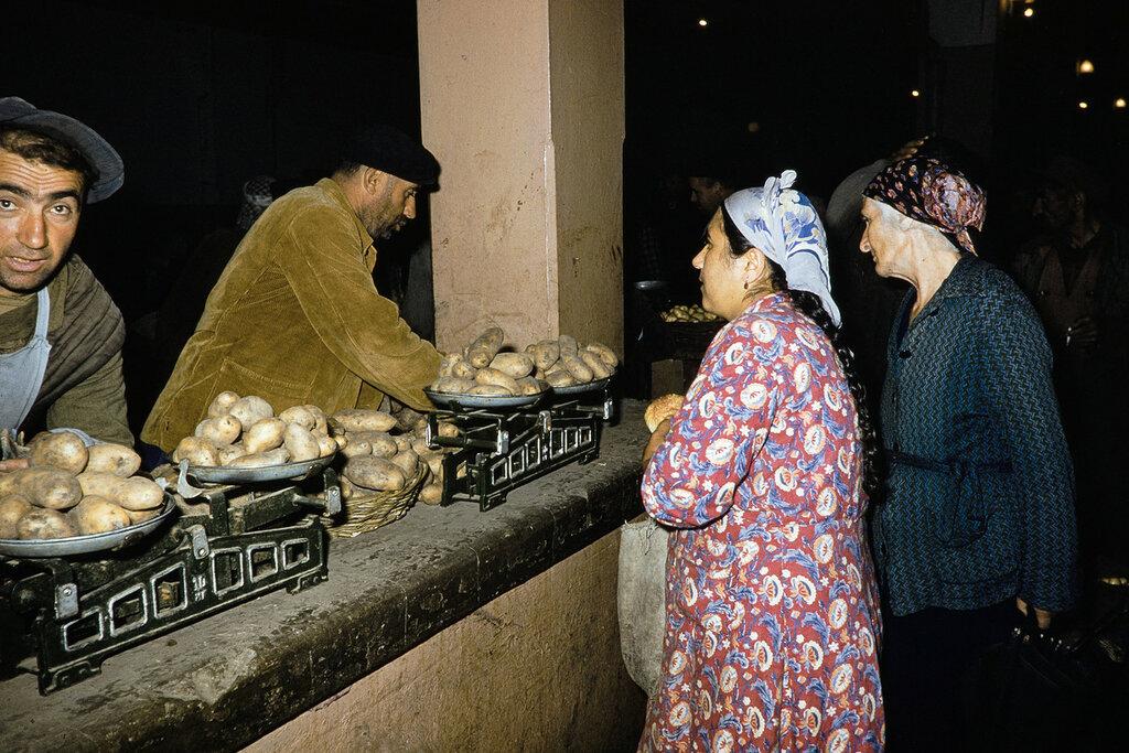 Georgia, merchants selling potatoes at market