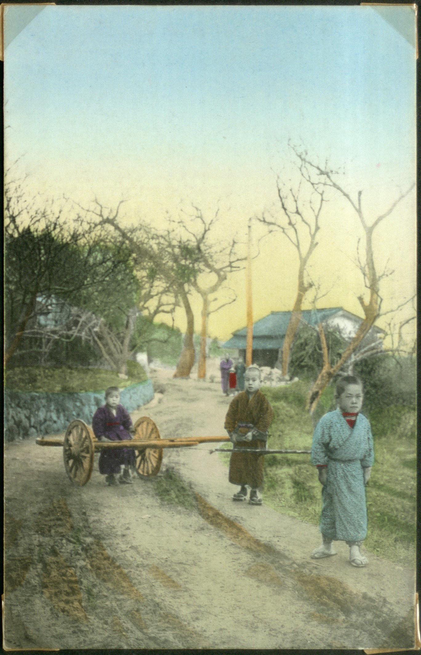 Деревенские дети с тележкой