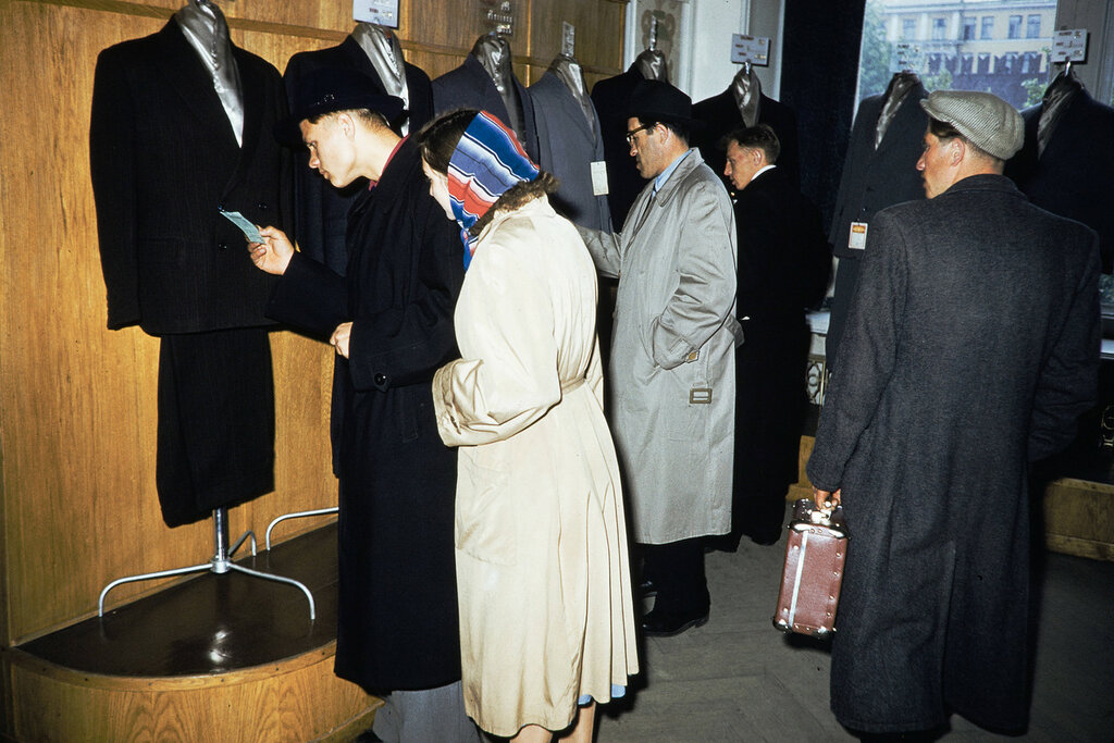 Russia, people looking at suit display at store in Moscow