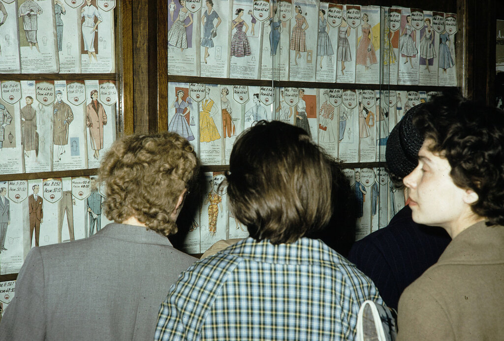 Russia, women looking at dress patterns in Moscow