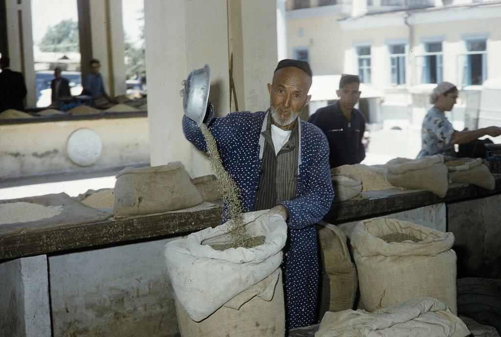 Uzbekistan, merchant at Samarkand market