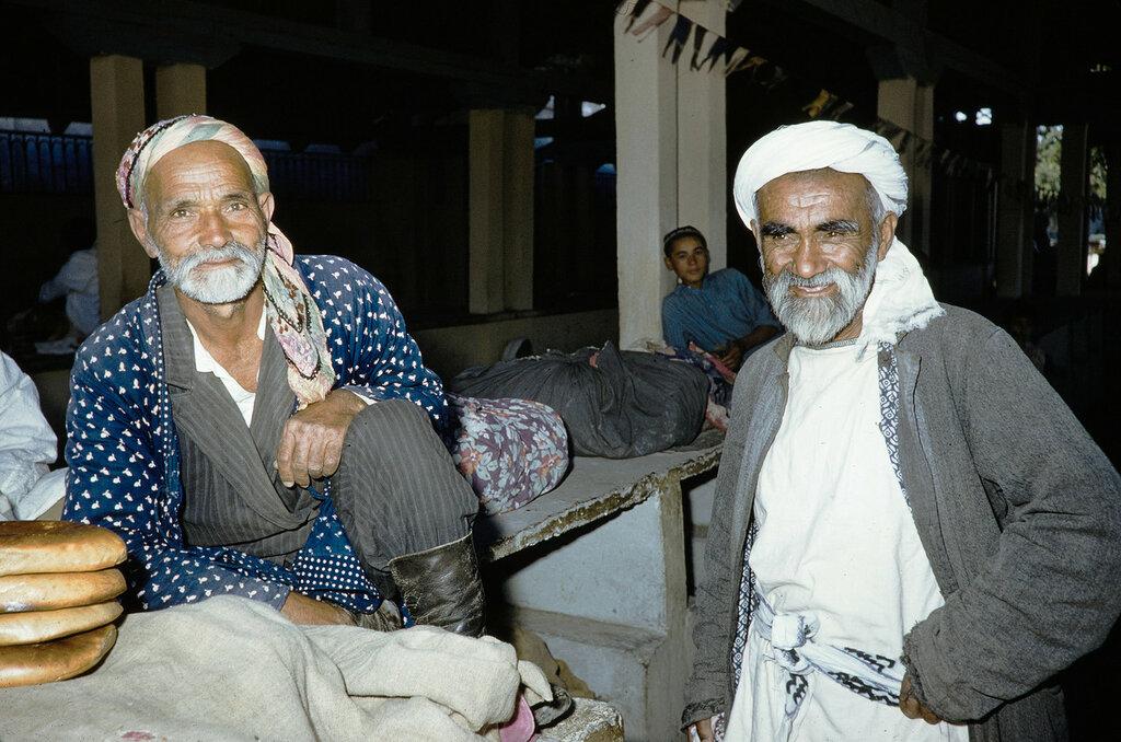 Uzbekistan, men relaxing in tea shop in Samarkand