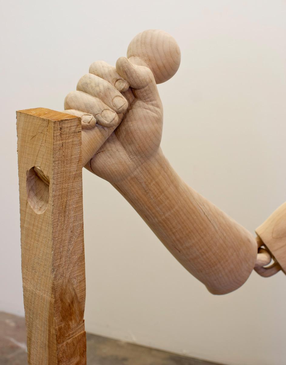 Его необычная серия деревянных скульптур , изображающих руки, причем, рабочие руки, имеет под собой