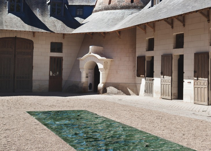 It reflects on the hidden presence of the Loire river, which flows beneath the courtyard of the Doma
