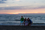 Family and Sunset at North Sea