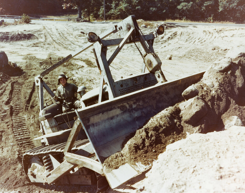 """""""Seabee"""" Bulldozer. Digs out, lifts and pushes rock and dirt at the construction Battalion Training Center, Camp Endicott, Davisville, R.I., during the fall of 1943."""