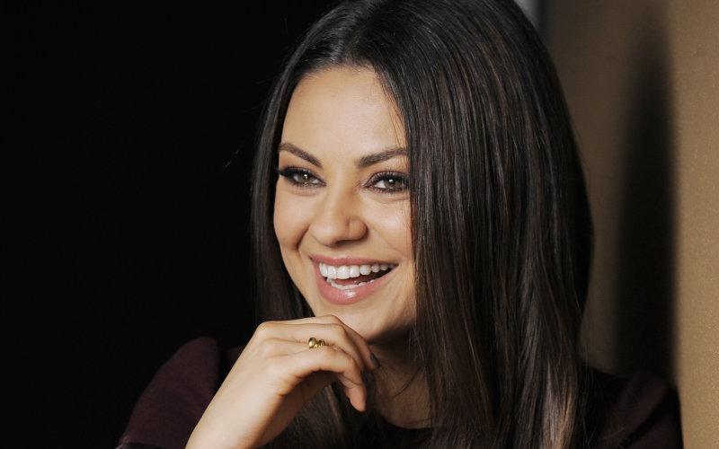 Актриса и певица Дженнифер Лопес со своей ослепительной улыбкой.