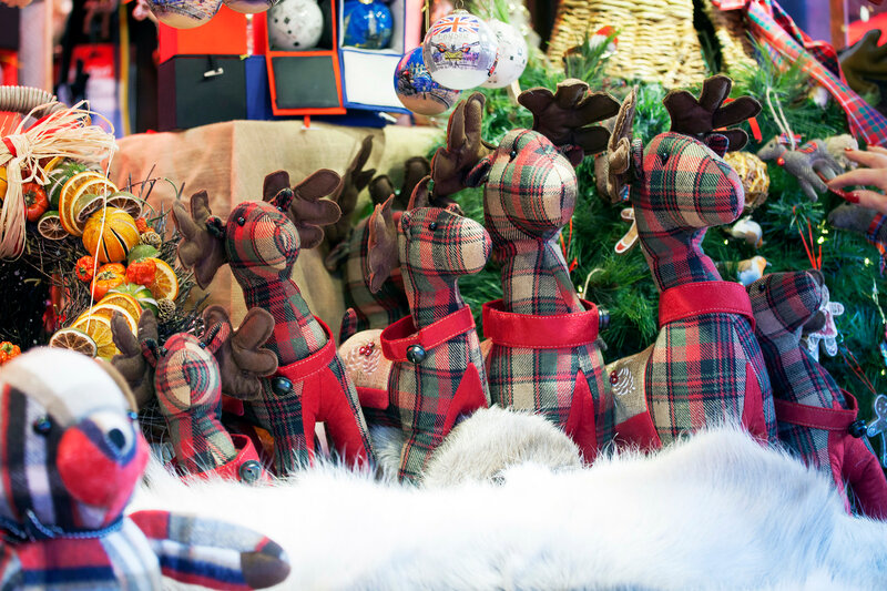 teddy bear, deer, and Christmas decorations on the Christmas market