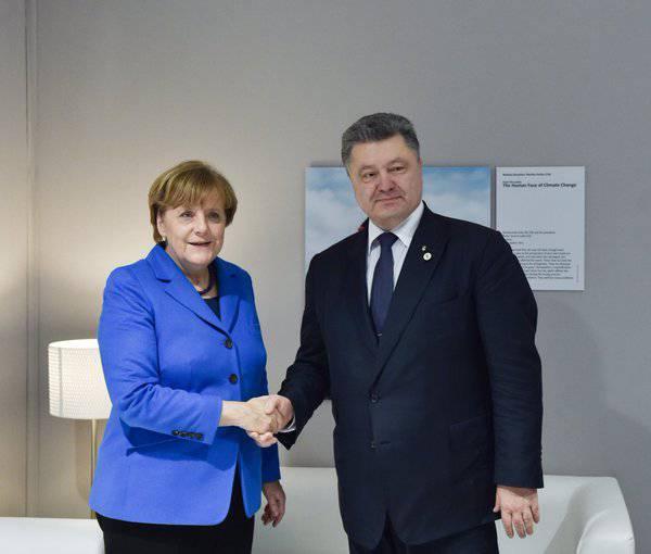 Меркель призвала Порошенко к решительным шагам для реализации минских соглашений