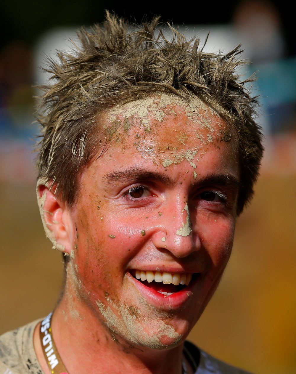 A competitors is seen after finishing the Wildsau Dirt Run (Wild Boar Dirt Run) obstacle course fun race at Hellsklamm ravine in Obertriesting