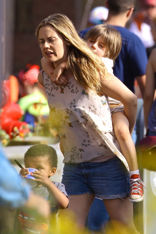EXCLUSIVE: Alicia Silverstone gives son Bear a piggy back ride at Disneyland