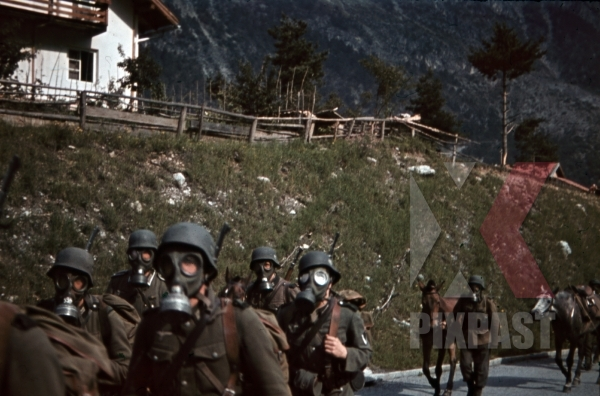 stock-photo-mountain-troopers-marching-with-gas-masks-in-landeck-austria-1941-11349.jpg