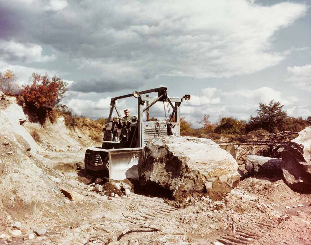 """""""Seabee"""" Bulldozer. Moves a very large rock, at the construction Battalion Training Center, Camp Endicott, Davisville, R.I., in the fall of 1943."""