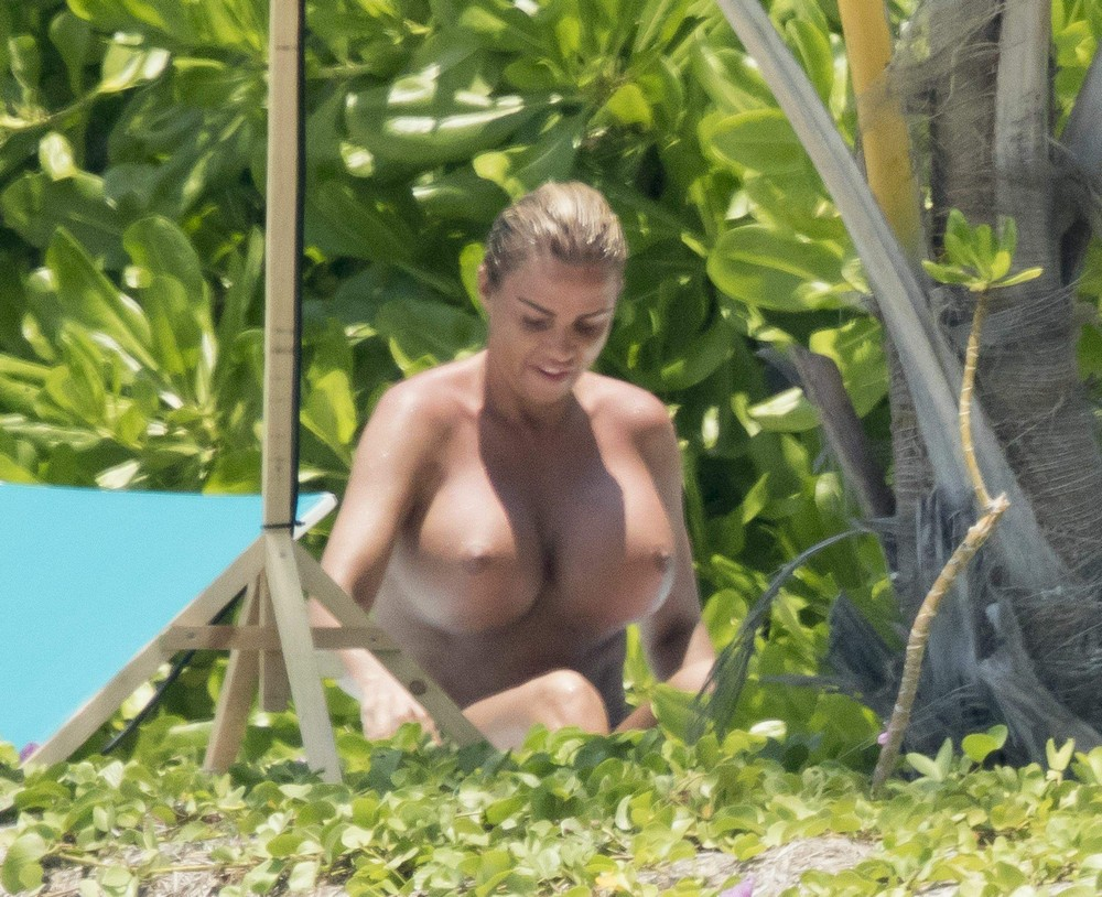 Katie Price topless on the beach