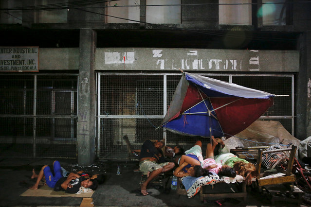 People sleep in open air, on a street in Tondo, Manila, Philippines early October 18, 2016. Local re