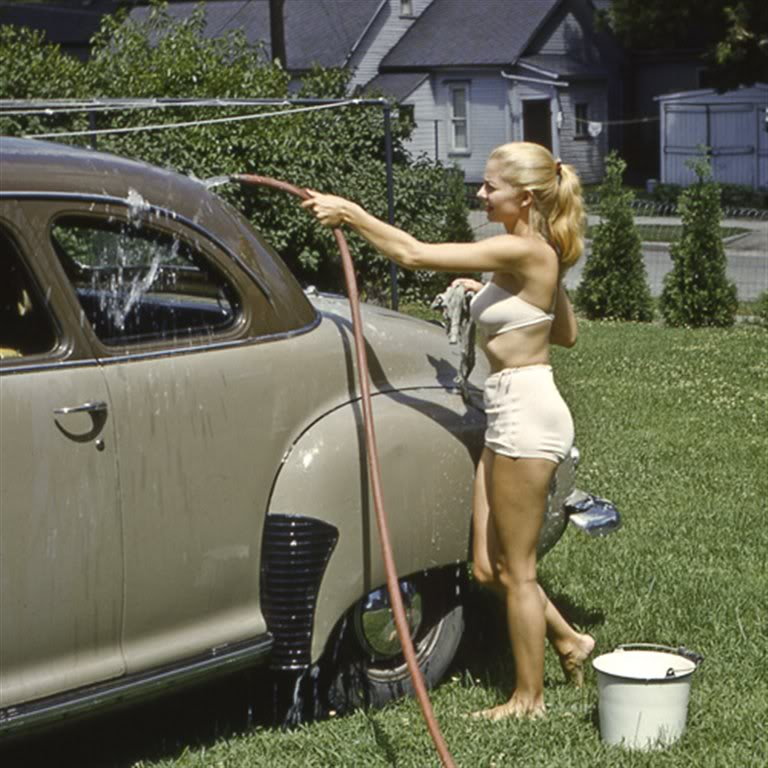 Color photo of lady washing her Nash 400 in 1953.jpg