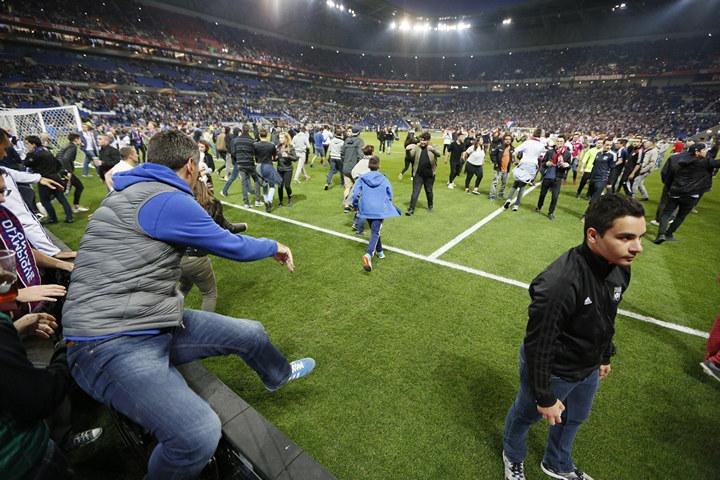 Lyon fans on the pitch