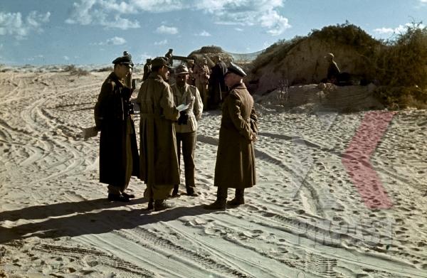 stock-photo-field-marshal-erwin-rommel-talks-with-army-generals-tunisian-desert-1942-12451.jpg