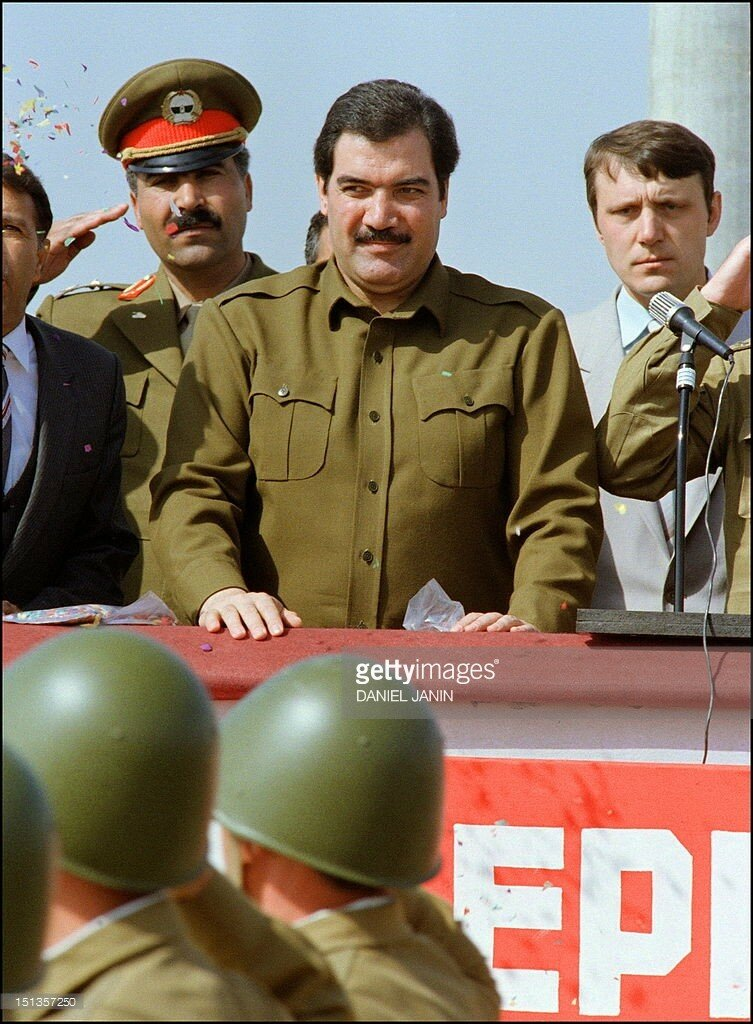Afghanistan's president Mohammed Najibullah (C) smiles as he reviews Red Army soldiers marching 17 October 1986 in downtown Kabul during a parade shortly before they returned to the Soviet Union.jpg