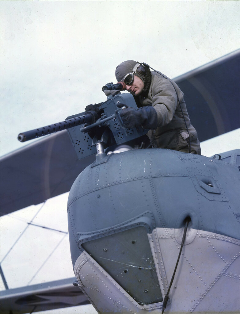 U. S. Coast Guard bow gunner William M. Sikorski at his position in a U. S. Coast Guard Hall PH-3 in flight, ca. 1943.