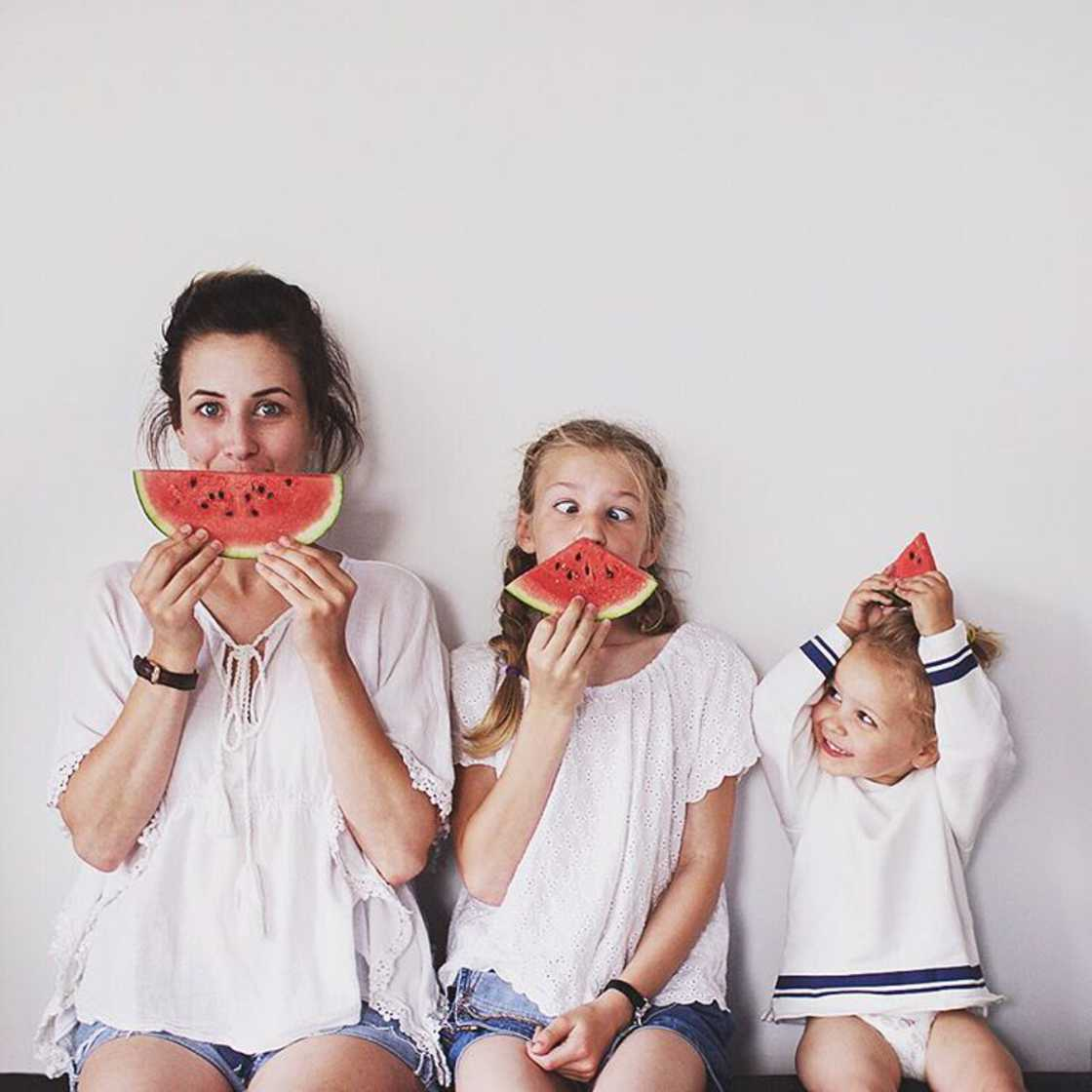 Mom and Girls - She poses with her two little girls in matching clothes
